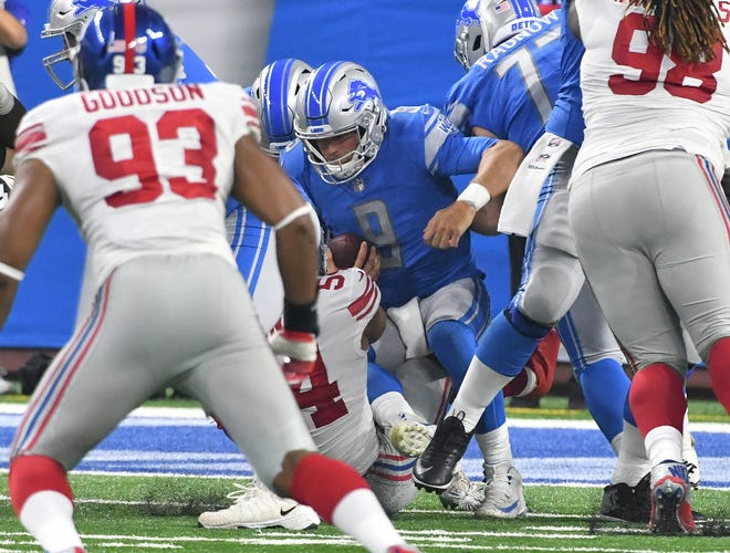 Lions quarterback Matthew Stafford is sacked for the second time in the first half of Friday's preseason loss to the Giants.