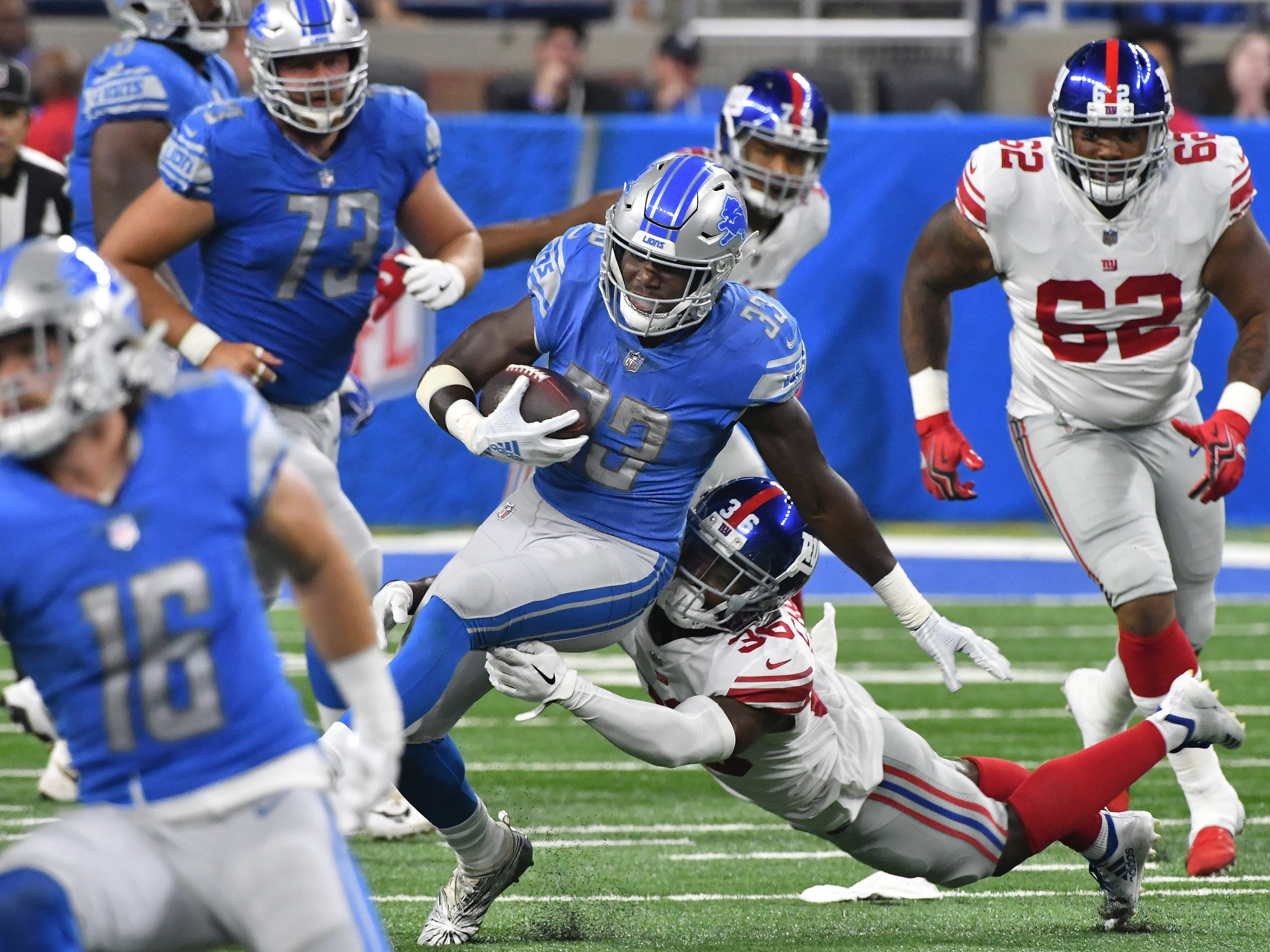Lions running back Kerryon Johnson scrambles up field in the fourth quarter.