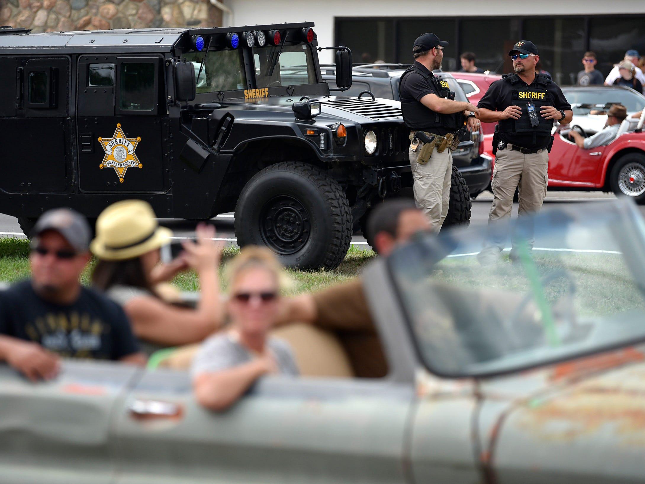 Oakland County Sheriff's SWAT officers watch motorists from the median in Royal Oak.
