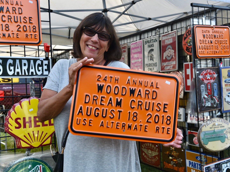Patt Stoltz of Nekoosa, Wisconsin, holds her Woodward Dream Cruise sign.