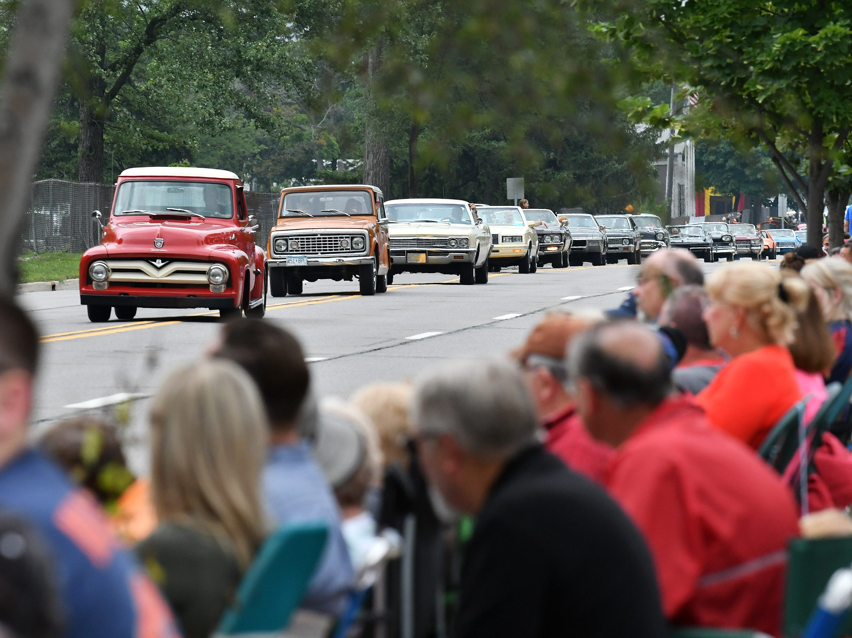 People line 12 Mile for the Berkley CruiseFest Classic Car Parade.