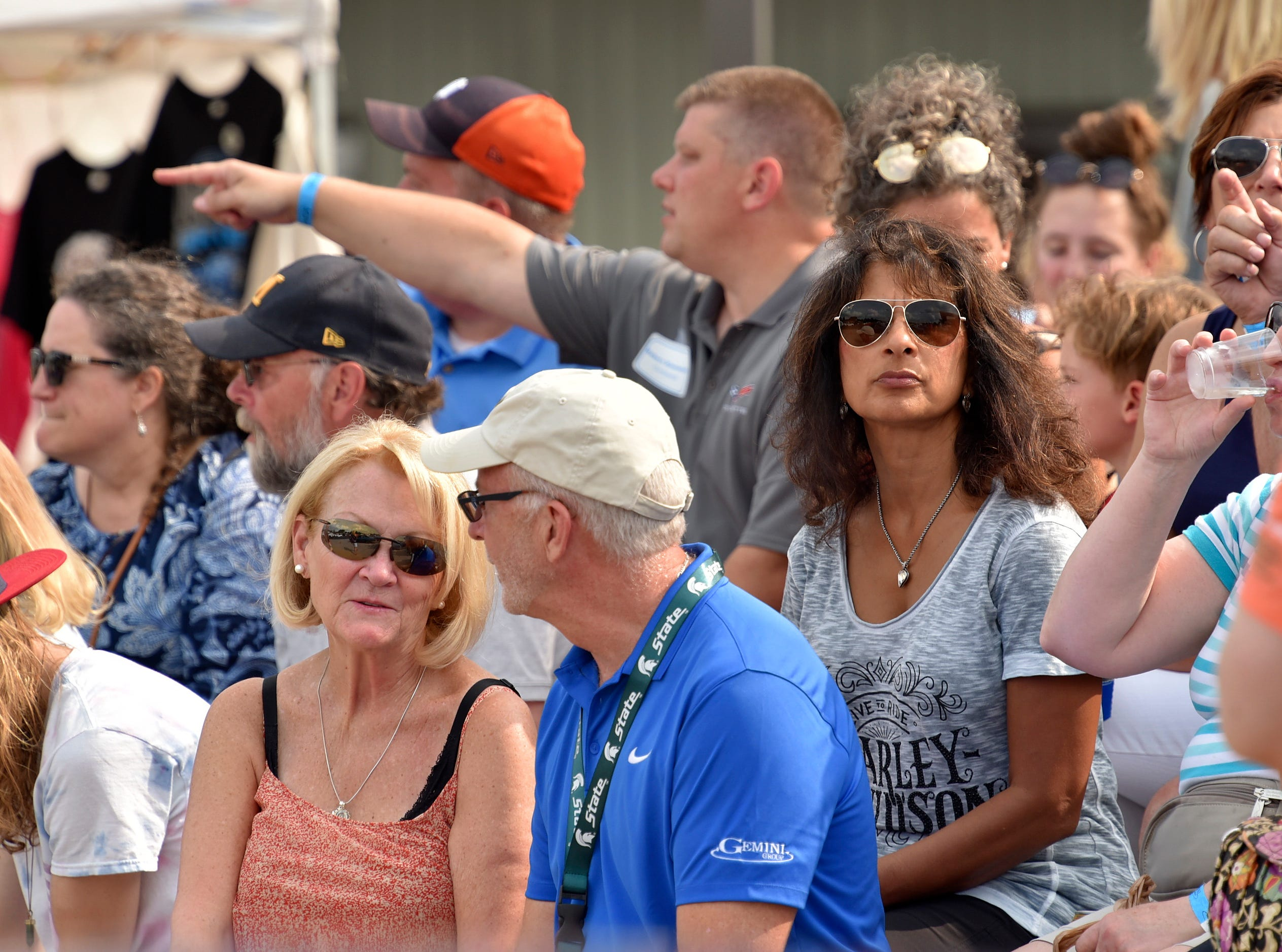 Spectators watch the Dream Cruise from the bleachers in front of  The Original Pancake House in Royal Oak.