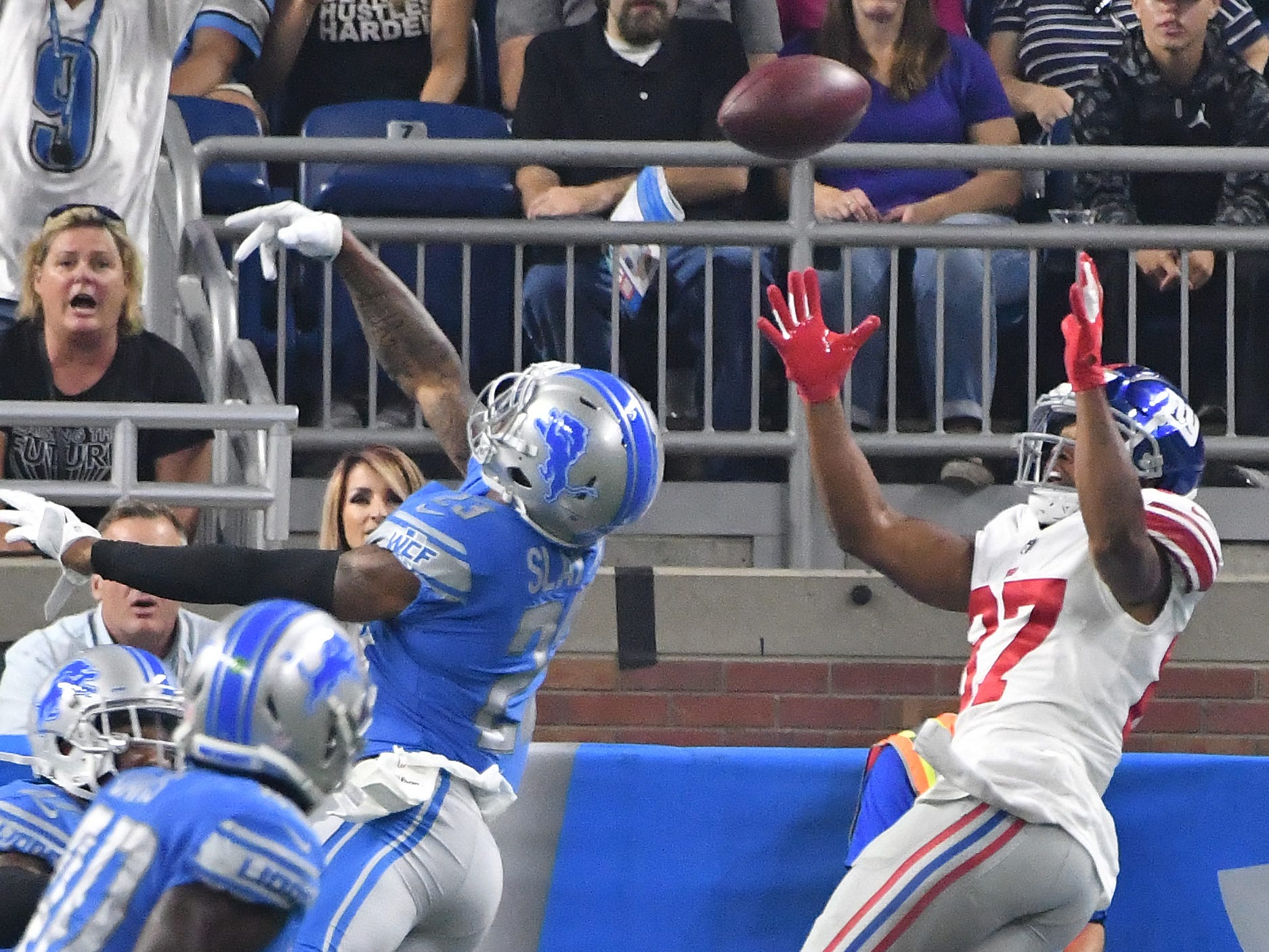 Lions' Darius Slay is able tip the ball, breaking up a pass intended for Giants' Sterling Shepard in the end zone in the first quarter.