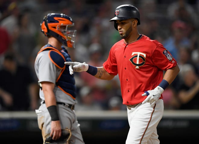 James McCann of the Tigers looks on as Eddie Rosario of the Twins celebrates a solo home run during the sixth inning.