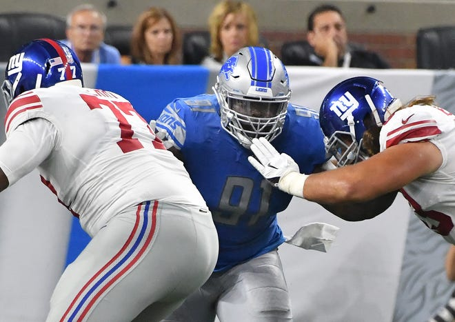Lions defense tackle A'Shawn Robinson works on the defensive line in the fourth quarter of a preseason game.
