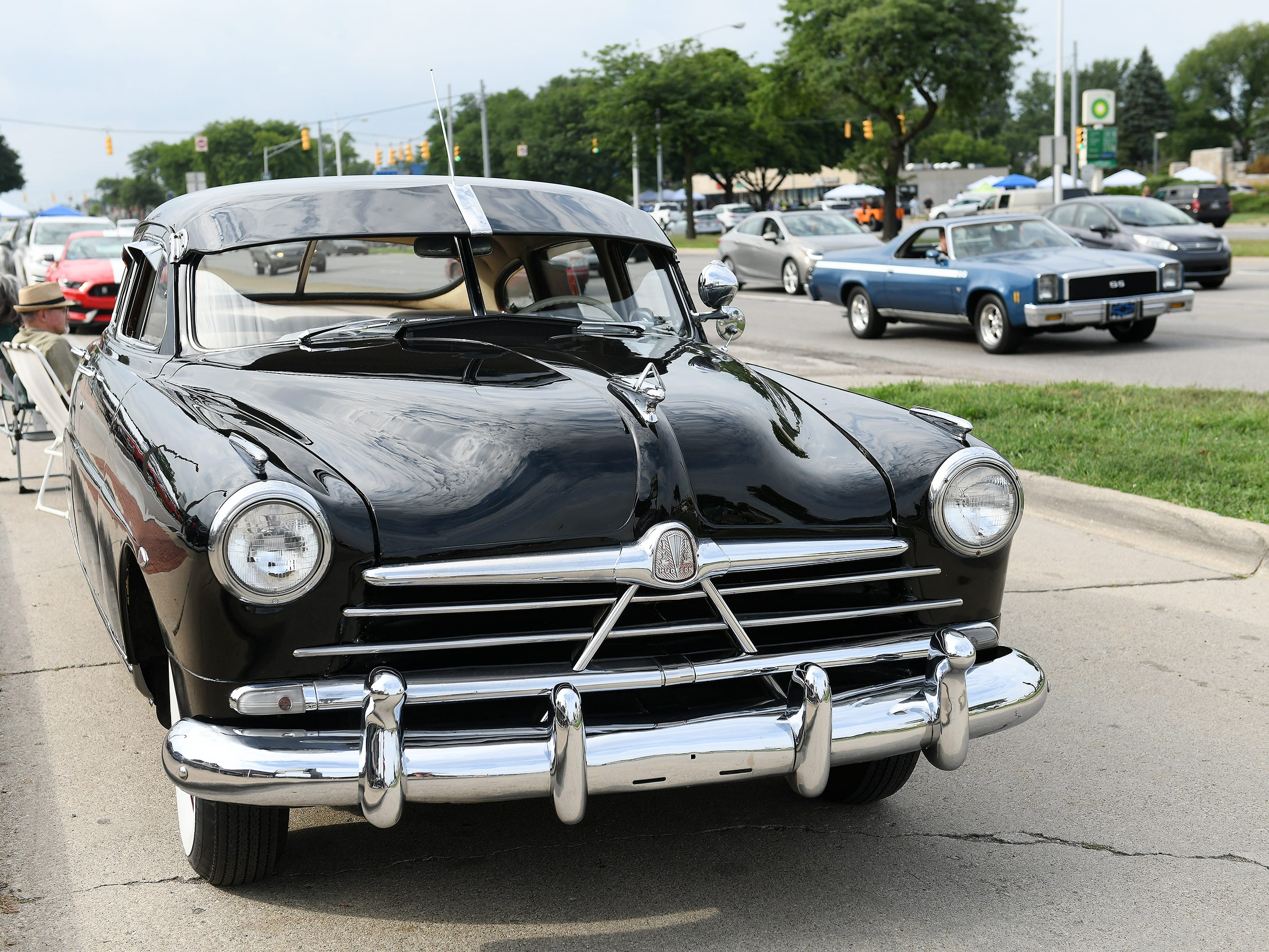A 1950 Hudson Super Six belonging to Heidi and Duane Sabella of New Baltimore sits along Woodward.