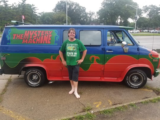 "Matthew Caron, 30, of Iona, Ontario, stands in front of his ""Scooby Doo"" creation."