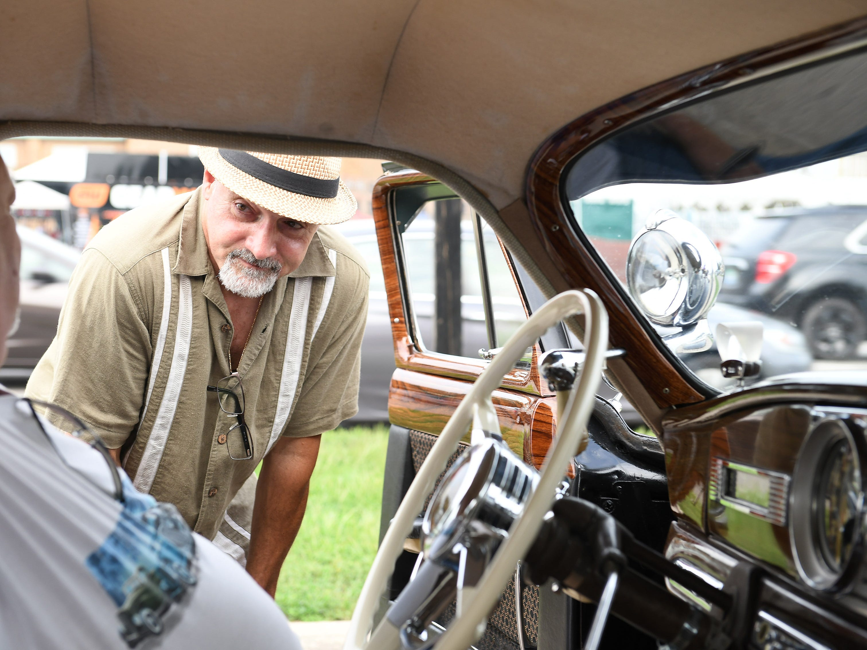 Duane Sabella of New Baltimore, right, talks with fellow Hudson owner John Albert of Cortland, Ohio, while Albert sits in Sabella's 1950 Hudson Super Six. Sabella's most recent project was redoing the car's interior.