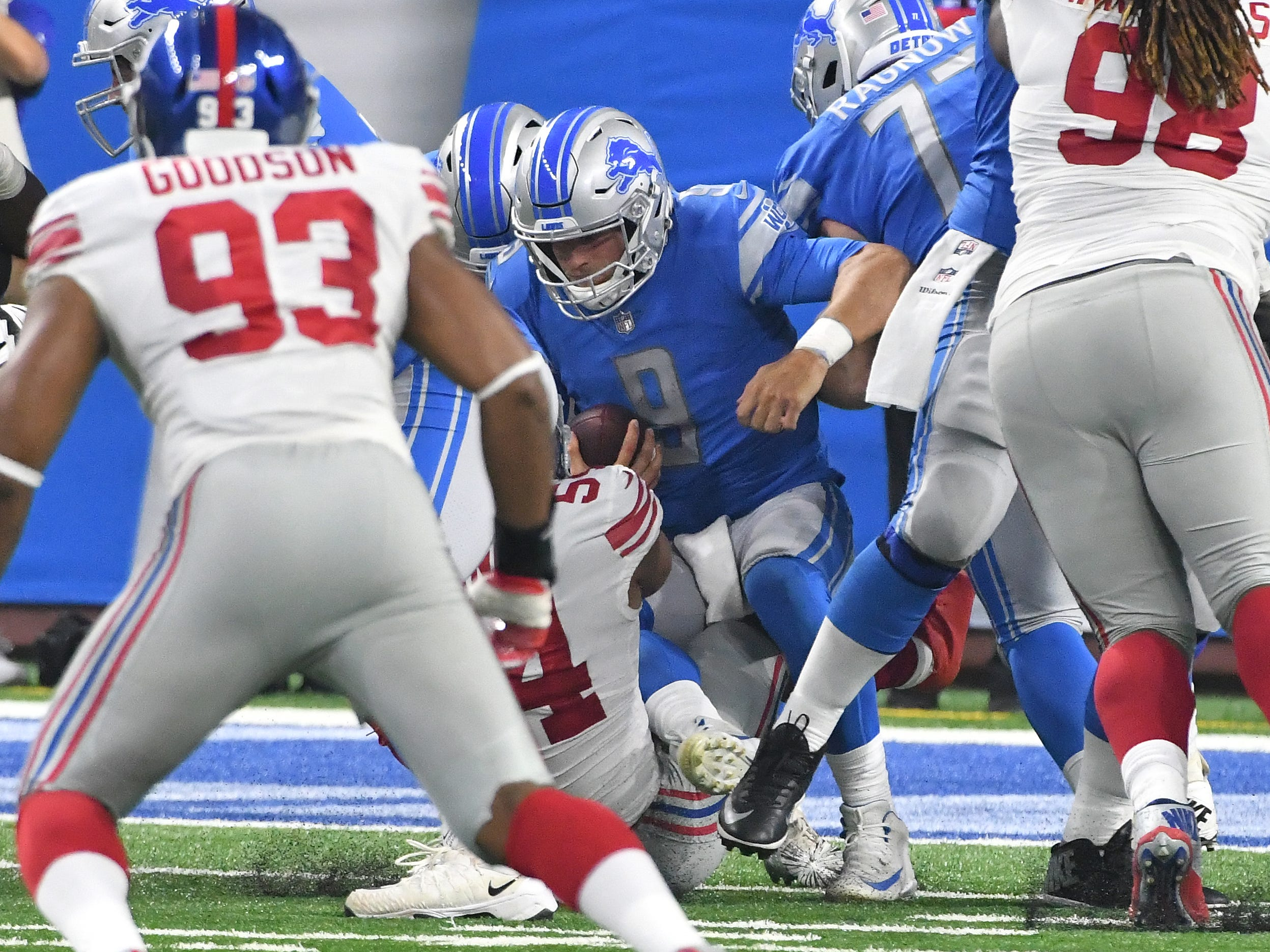 Lions quarterback Matthew Stafford is sacked for the second time in the first half.