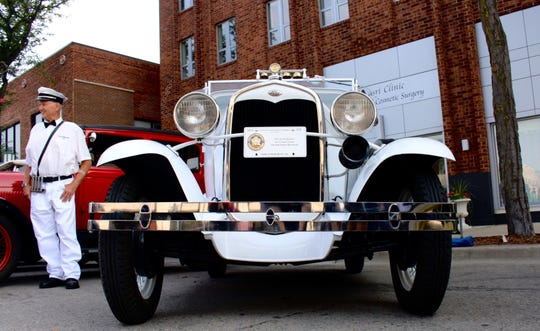"""Literally a cool ride. This 1931 """"Good Humors"""" Ford Model A ice cream truck is owned by Joe Hornacek, who dressed to match, in Birmingham."""