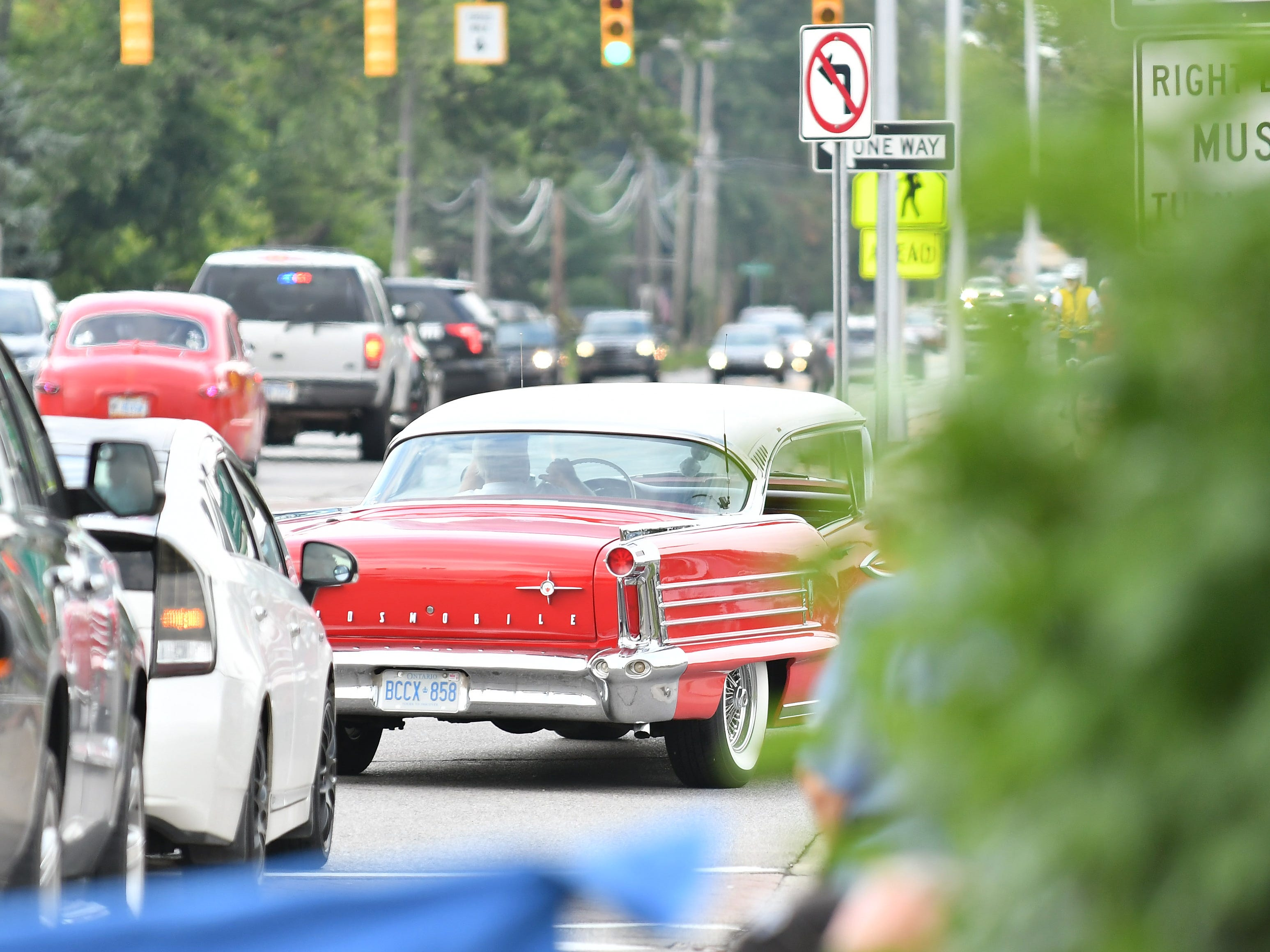 A classic Oldsmobile makes the turn from 12 Mile onto Woodward.