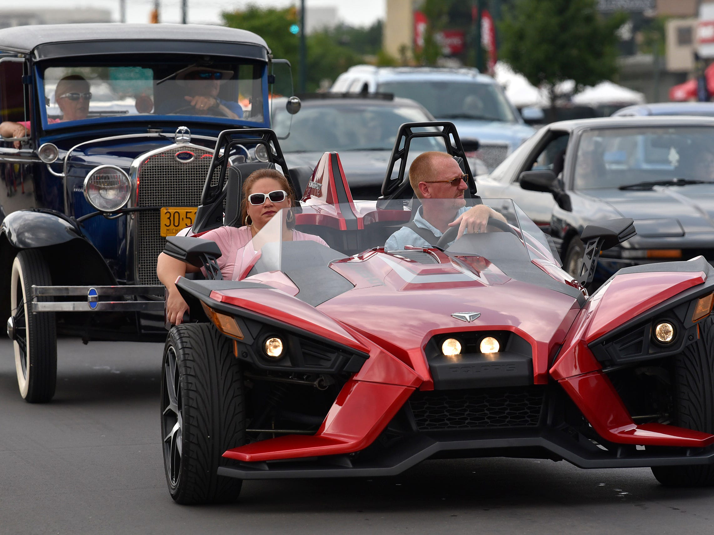 This 2017 Polaris Slingshot is followed by a 1930 Model A Ford.