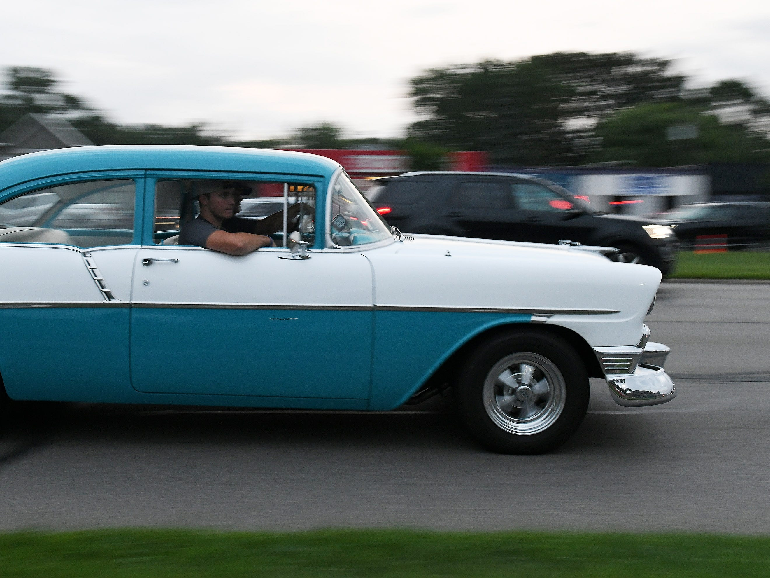 A classic car cruising on Woodward Avenue.