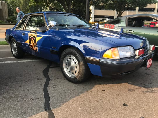 A 1992 Michigan State Police Special Service Package Mustang was parked in Mustang Alley on Saturday.