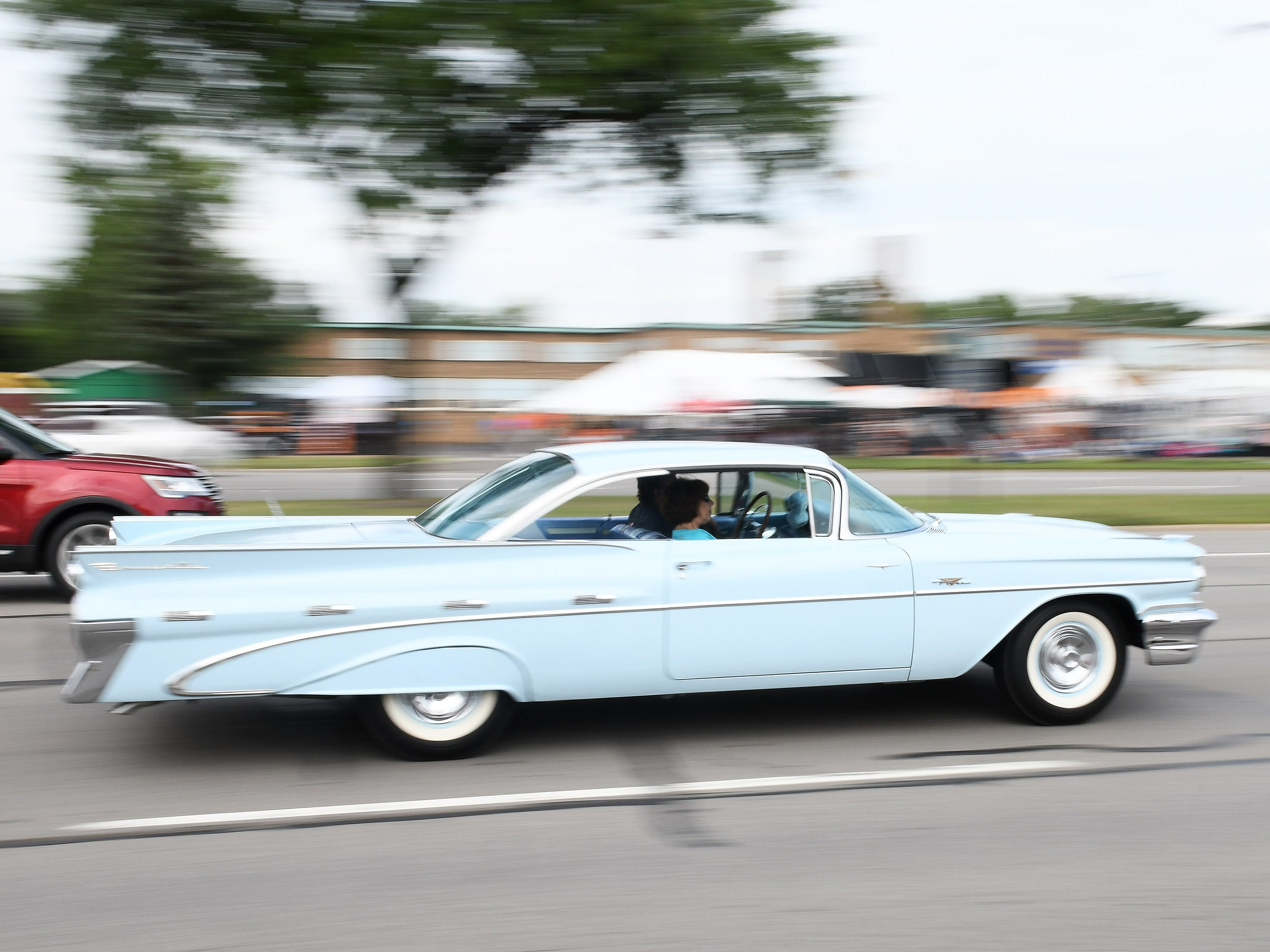 A classic car cruises Woodward.