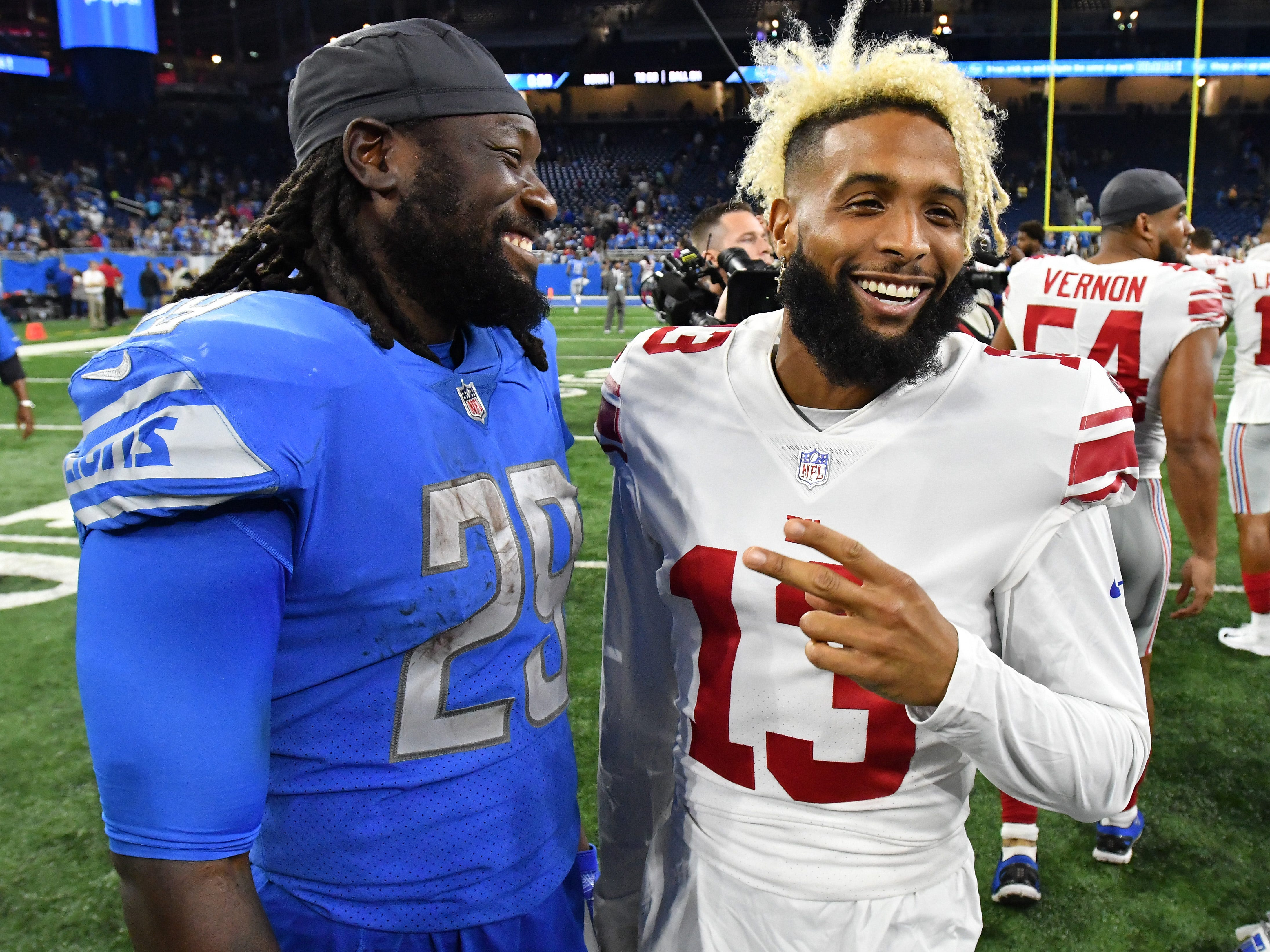 Lions running back LeGarrette Blount and Giants wide receiver Odell Beckham Jr. meet on the field after the 30-17 Detroit loss.