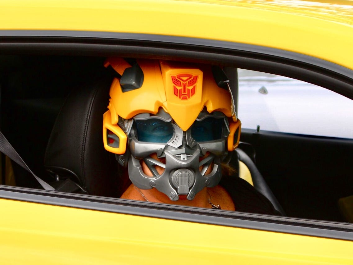 Robin DeDecker takes owning a Transformer Camaro seriously. That's why she was wearing a Bumblebee mask while cruising Woodward with her husband Mark. Even the late afternoon heat couldn't stop her.