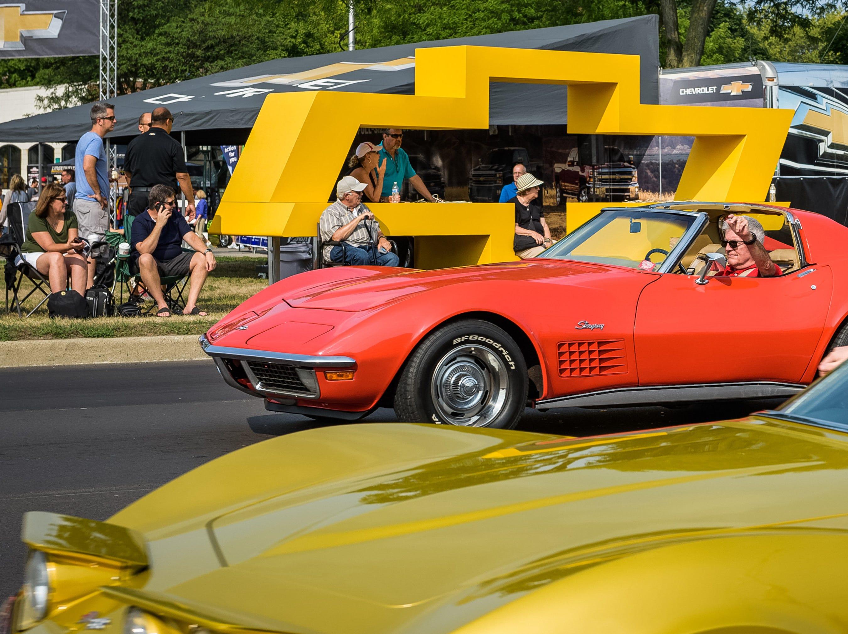 Vintage Corvette Stingrays drive up Woodward Avenue in Birmingham Saturday.