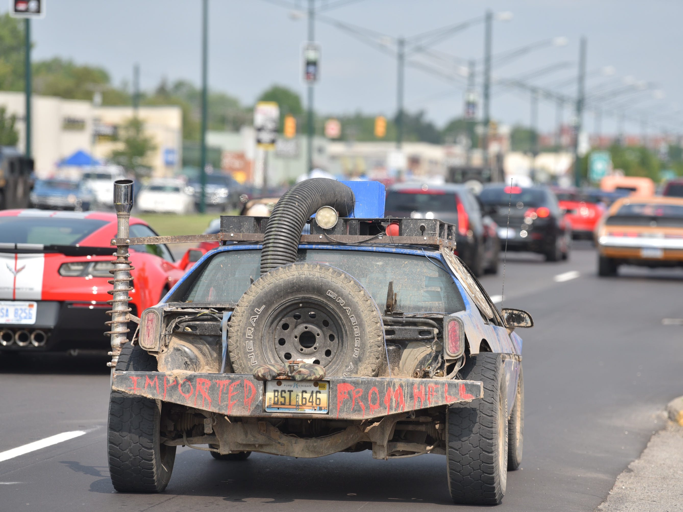"This modified car heading northbound on Woodward near 14 Mile says it's ""Imported From Hell."""