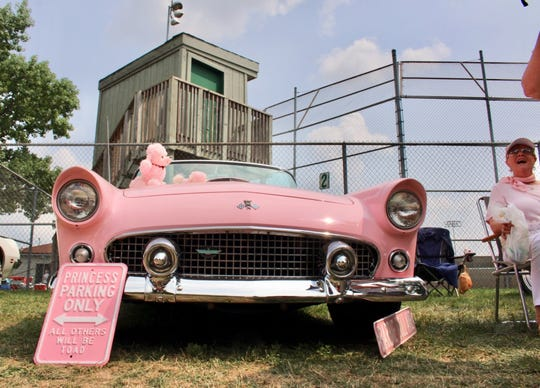 "Pat Wiegand owns a pink 1955 Ford Thunderbird she refers to as ""the Barbie car."""