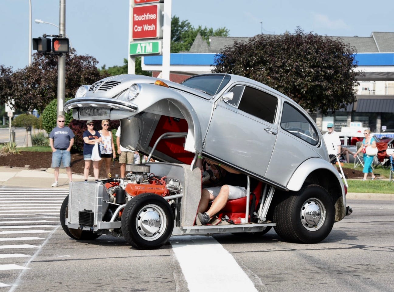 A clamshell VW motors down Woodward Avenue in Royal Oak.
