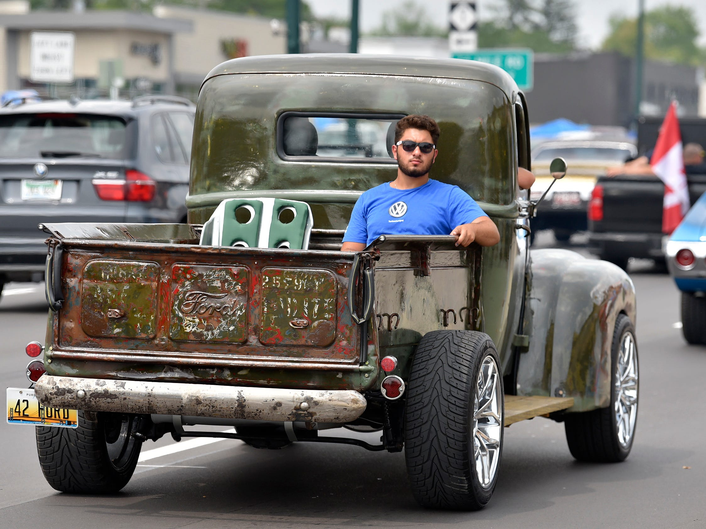 A cruiser rides in the bed of this 1942 Ford pick up truck.