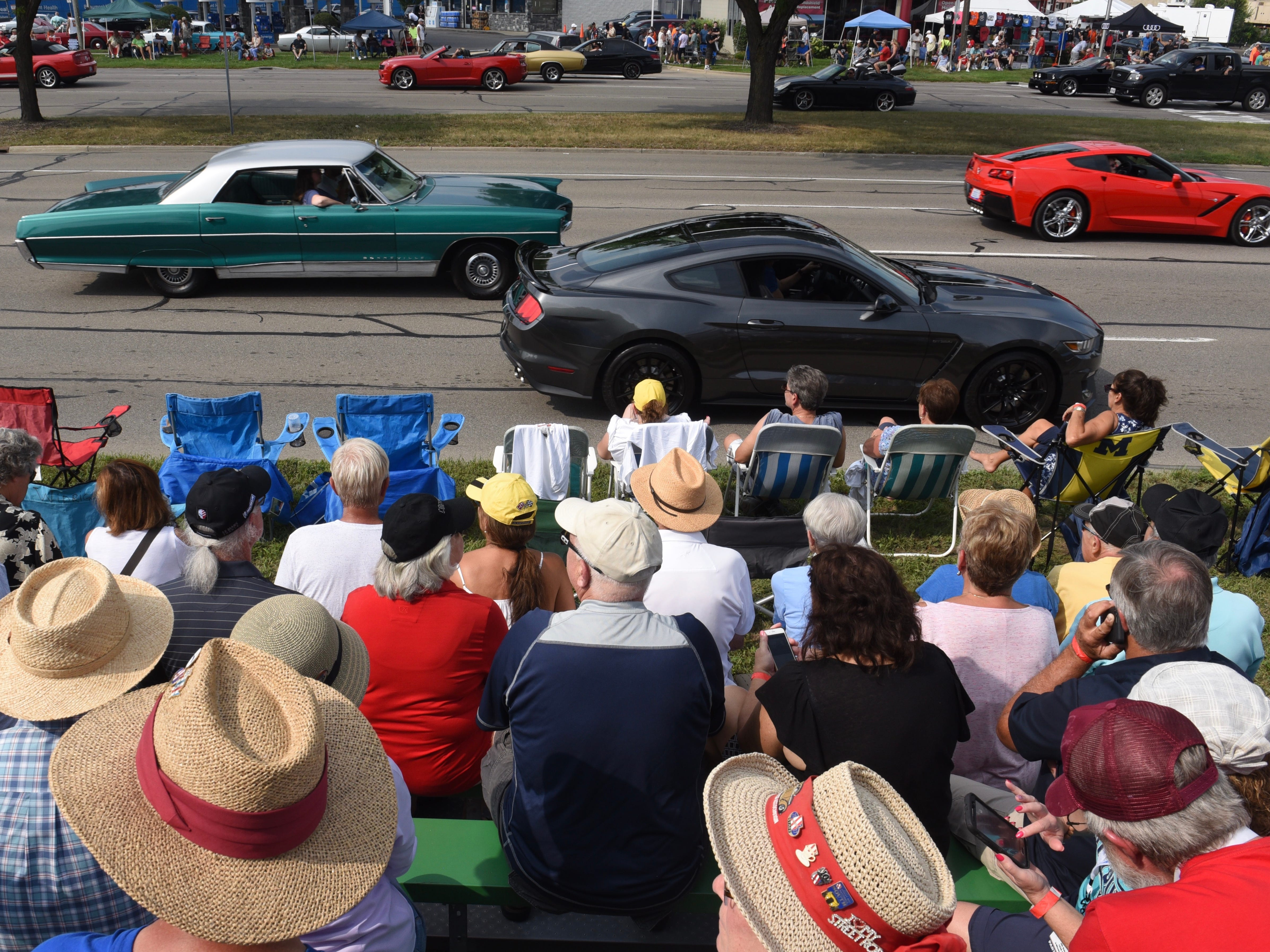 Spectators fill a grandstand for the Woodward Dream Cruise in Royal Oak.