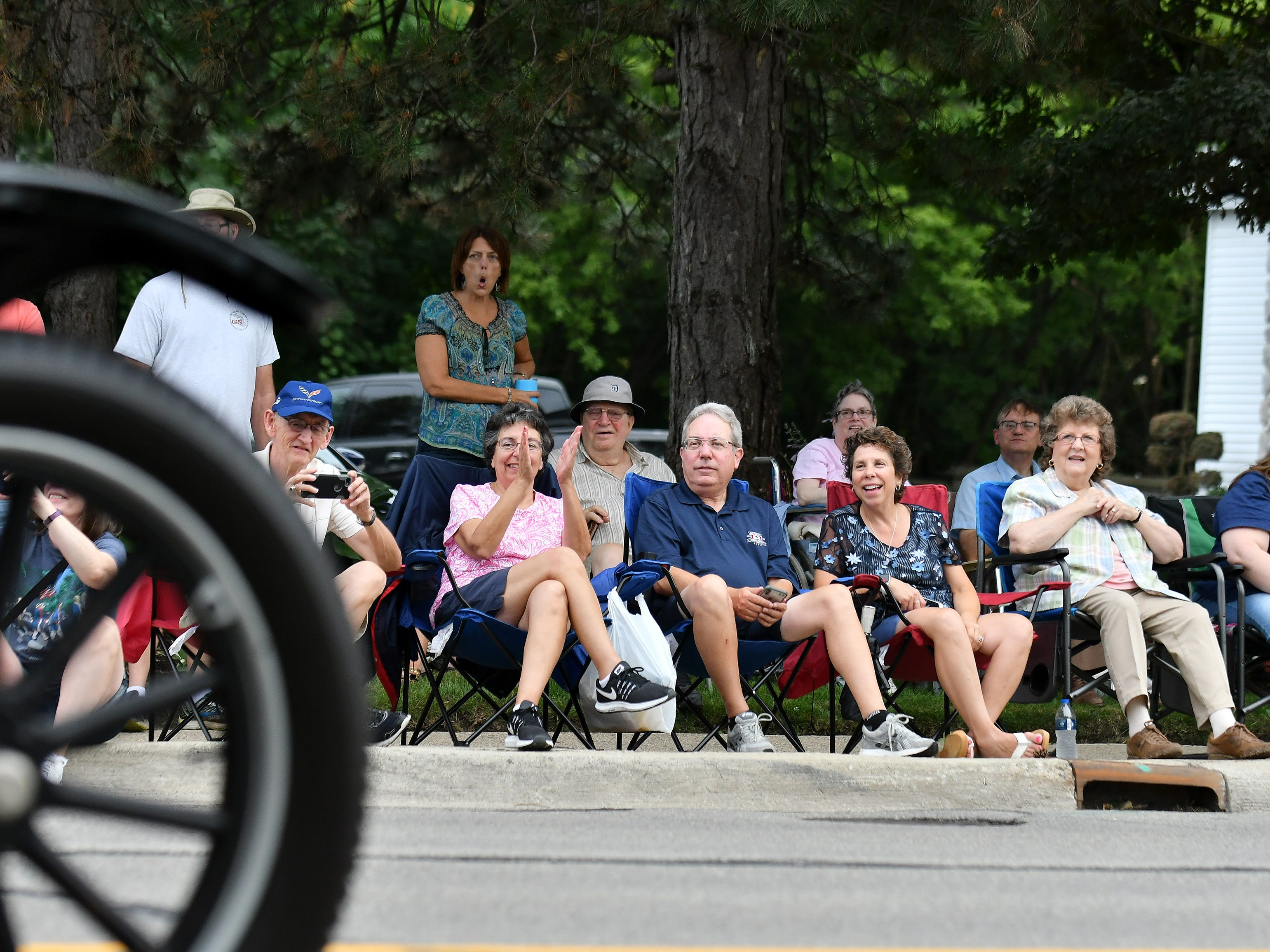 People watch a Ford Model T pass them at the Berkley CruiseFest Classic Car Parade.