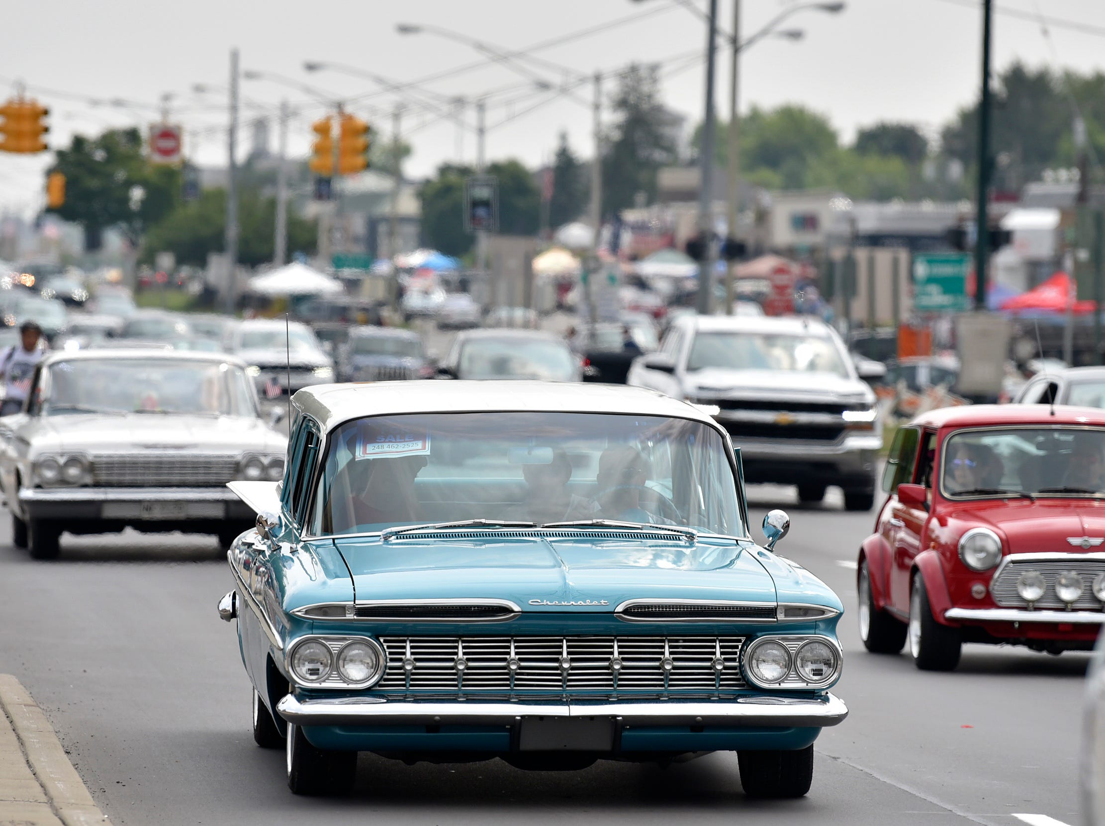 A 1959 Chevy Brookwood station wagon cruises Woodward Avenue.