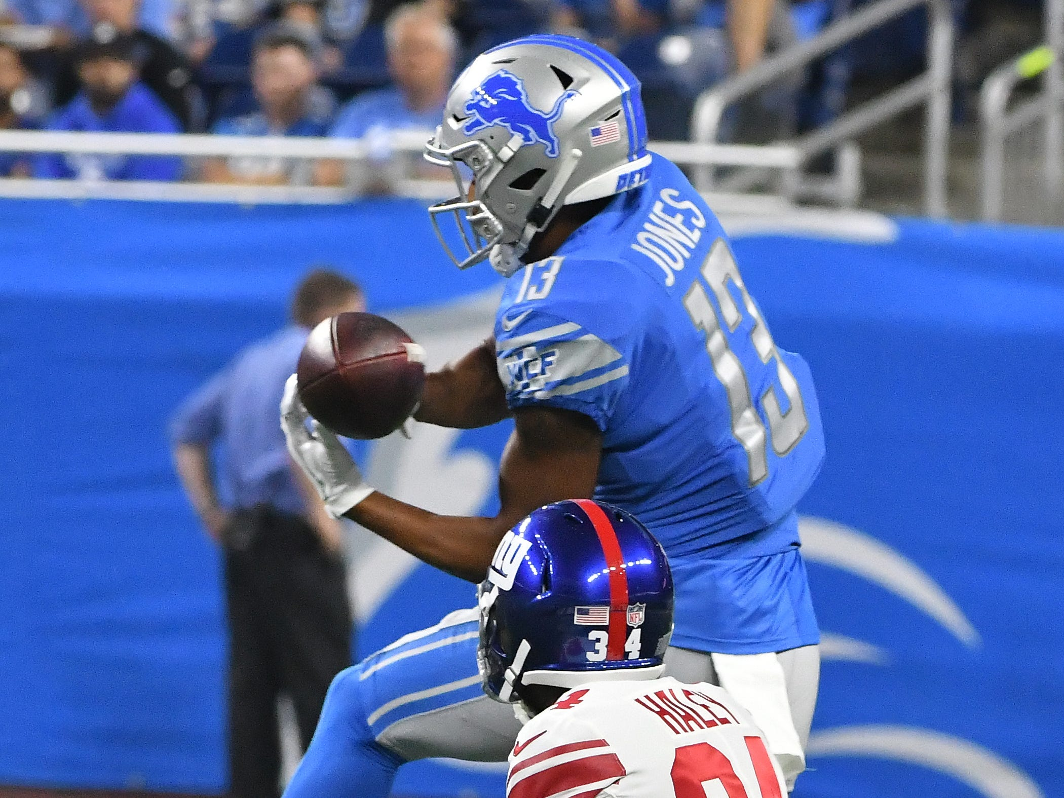 A pass slips past Lions wide receiver T.J. Jones hands, bounces off Giants' Grant Haley and into the hands of Giants' Ray-Ray Armstrong for an interception in the third quarter.