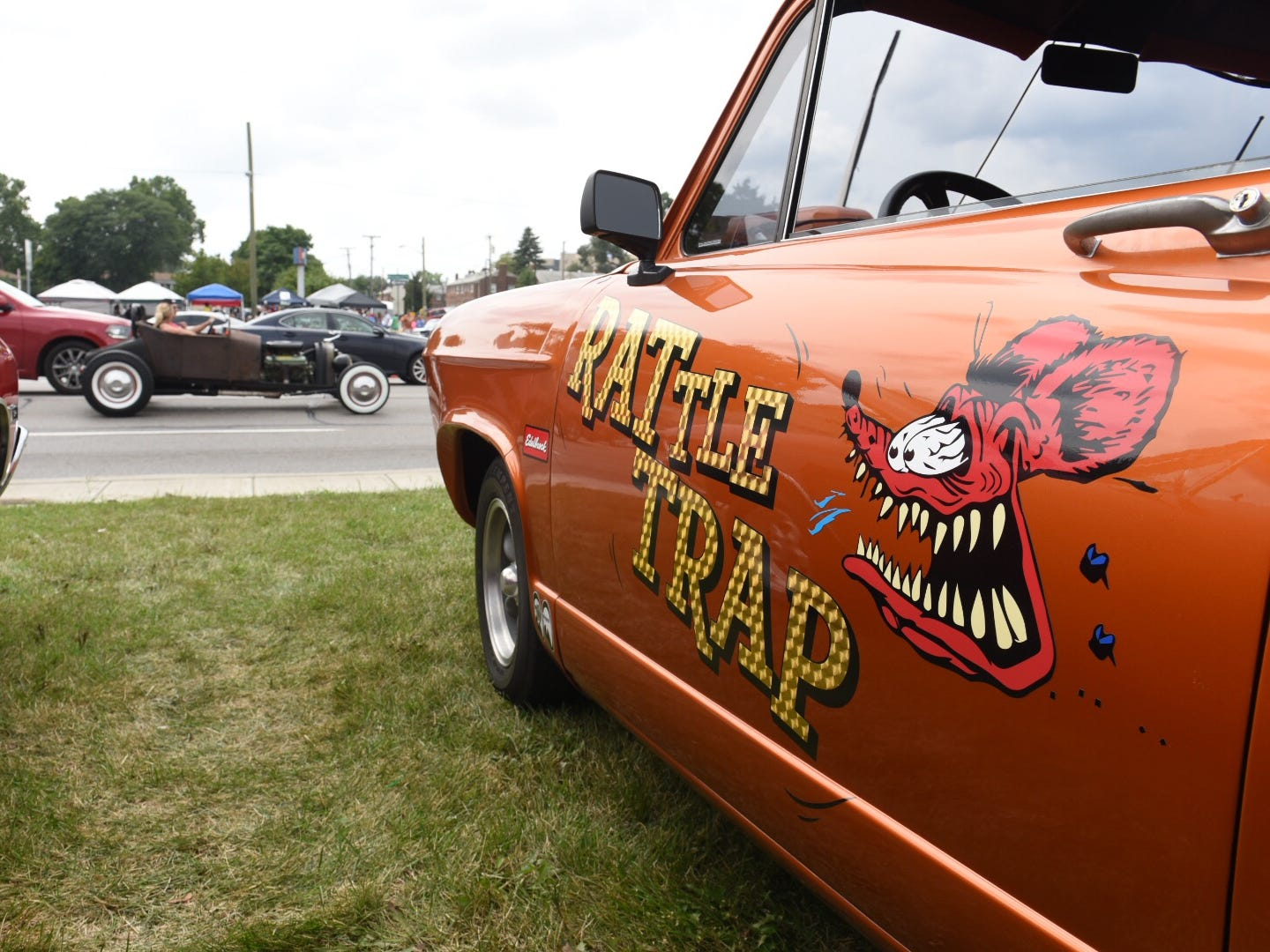 Custom paint is seen on a  Plymouth rattle trap car parked along Woodward Avenue.