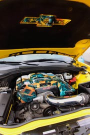 "The engine is emblazoned with the movie character Bumblebee and is ""bee powered."""