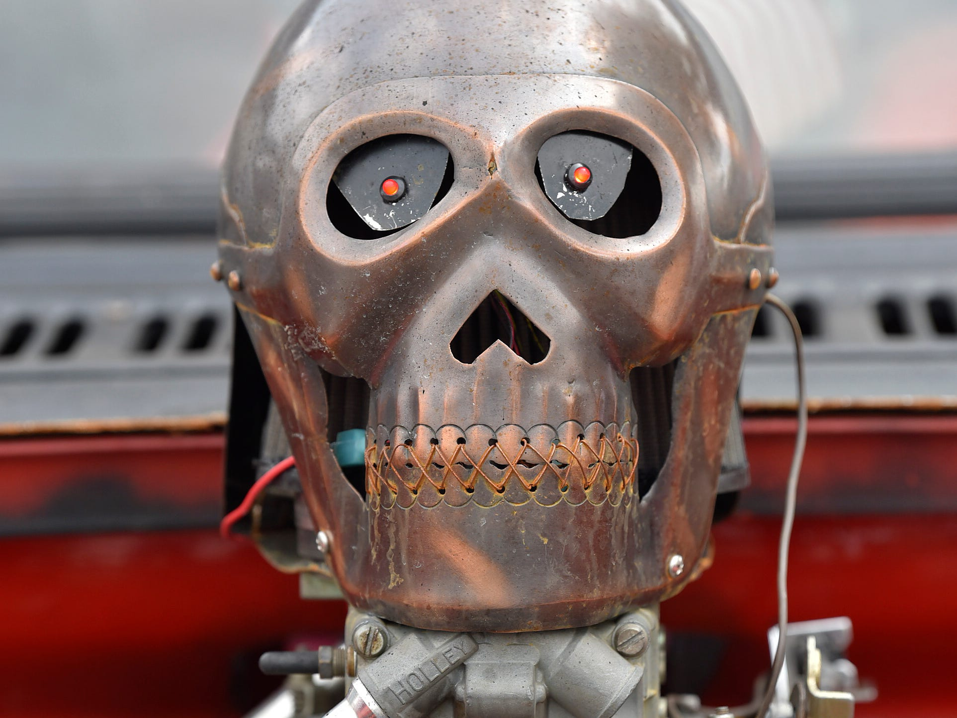 A skull air cleaner sits on top of a 327-cubic-inch Chevy motor on a 1965 D-100 Dodge Fleetside pickup truck owned by Dan Holdren, 61, of Oregon, Ohio.