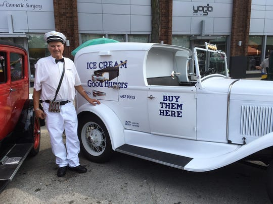 Joe Hornacek of Rochester Hills stands with his 1931 Model A ice cream truck — it was once found in pieces in a barn in Port Huron.