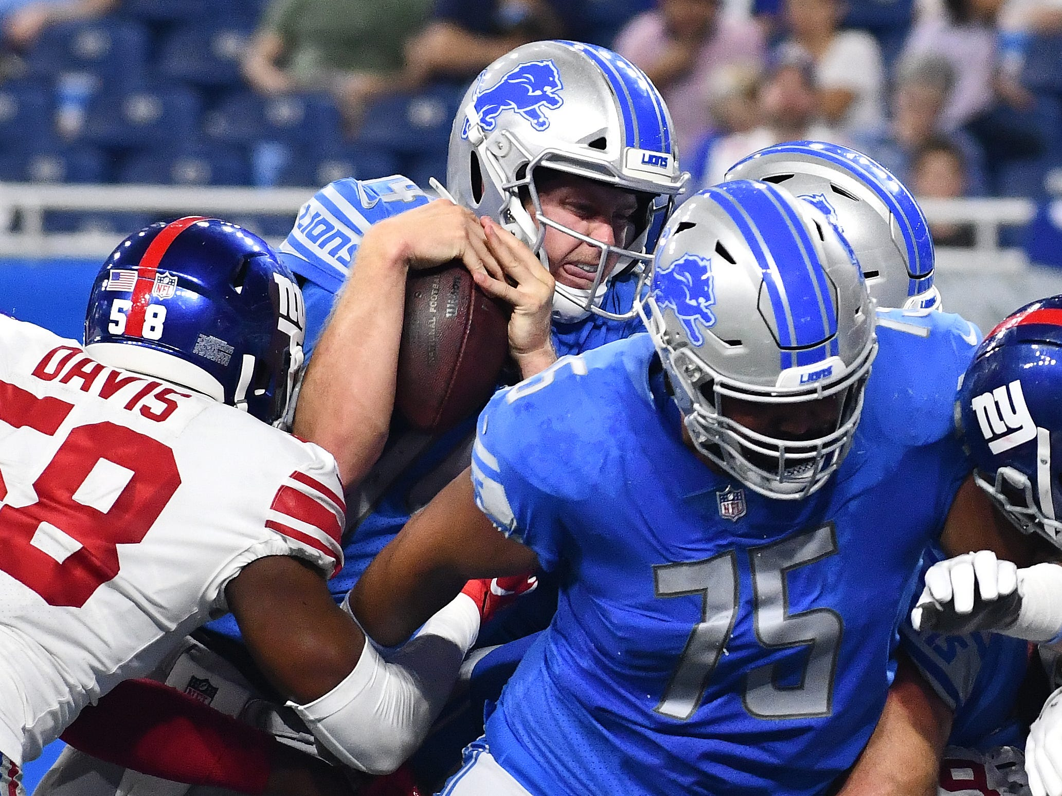 Lions quarterback Jake Rudock fights his way into the end zone for a touchdown in the fourth quarter.