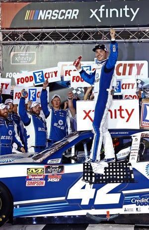 Kyle Larson celebrates after winning the NASCAR Xfinity Series race on Friday.