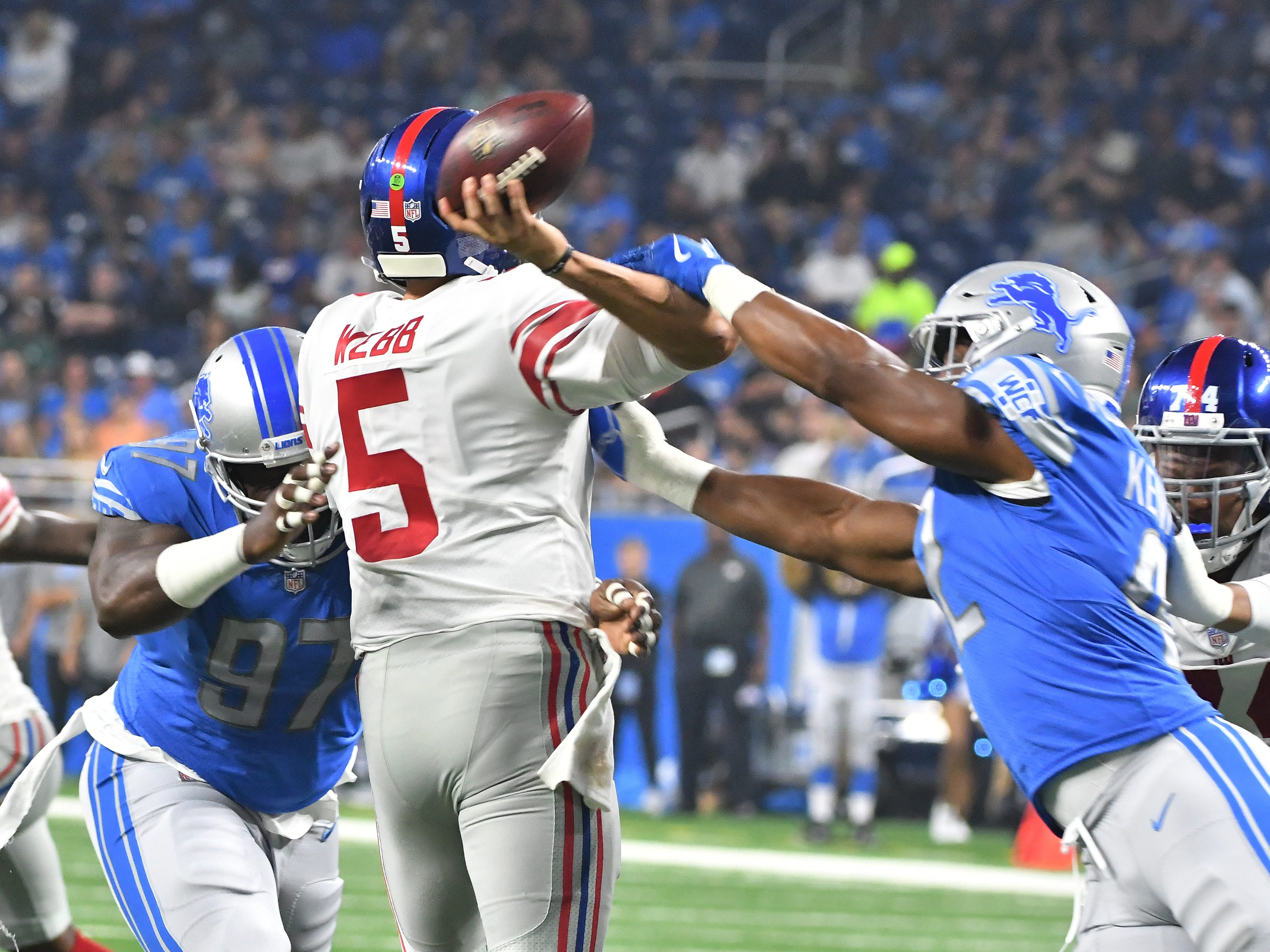 Lions' Devon Kennard gets a hand on Giants quarterback Davis Webb, causing a fumble, which Detroit recovered in the first quarter but after a review, it was ruled an incomplete pass.