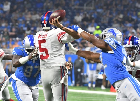 Detroit's Devon Kennard gets a hand on Giants quarterback Davis Webb, causing a fumble during the preseason.