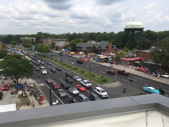 Swedish auto executive Bo Andersson could watch the Dream Cruise from one of the two penthouse patios of his apartment in Birmingham's Greenleaf Trust building.