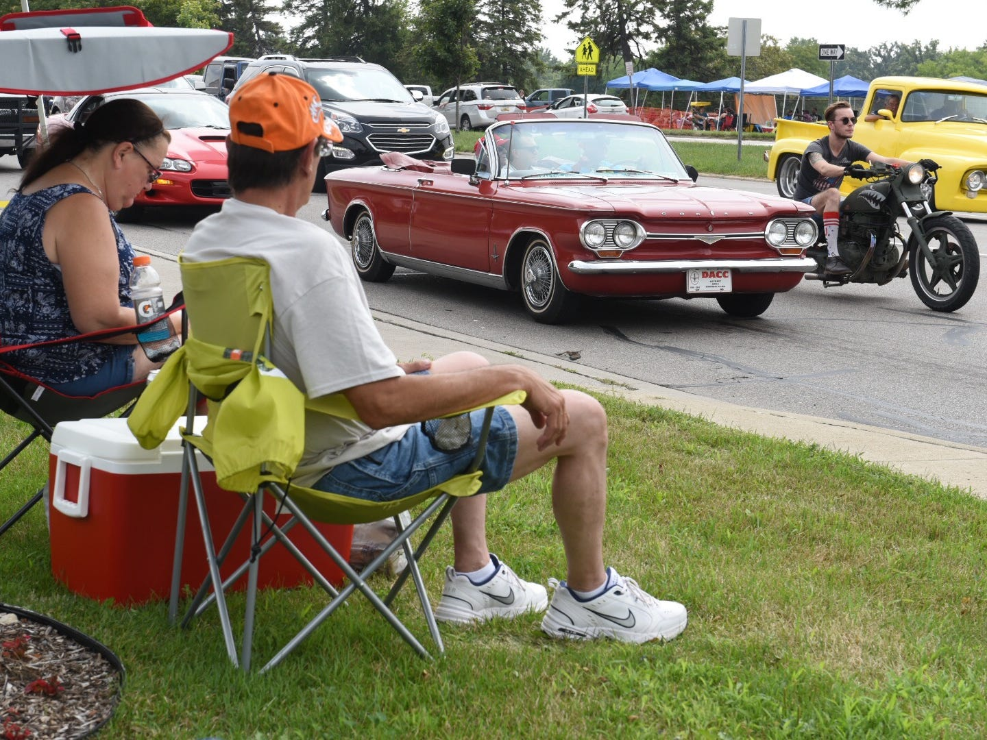 Spectators enjoy watching the classic cars traveling down Woodward Avenue in Royal Oak Saturday.