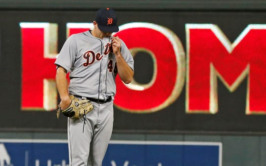 Tigers pitcher Matthew Boyd wipes his chin after giving up a solo home run to Twins' Eddie Rosario in the sixth inning.