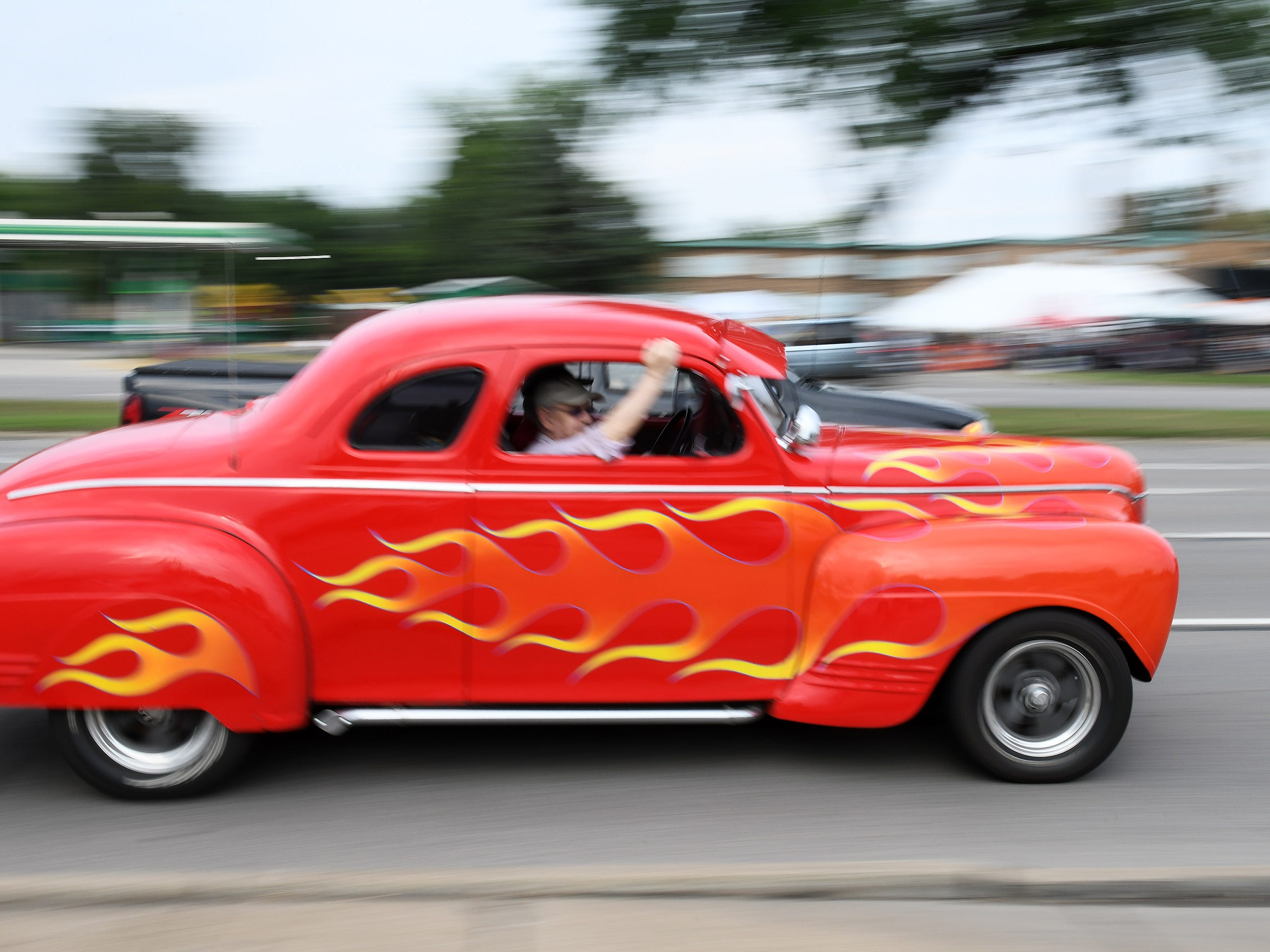 A flaming hot road cruises Woodward.