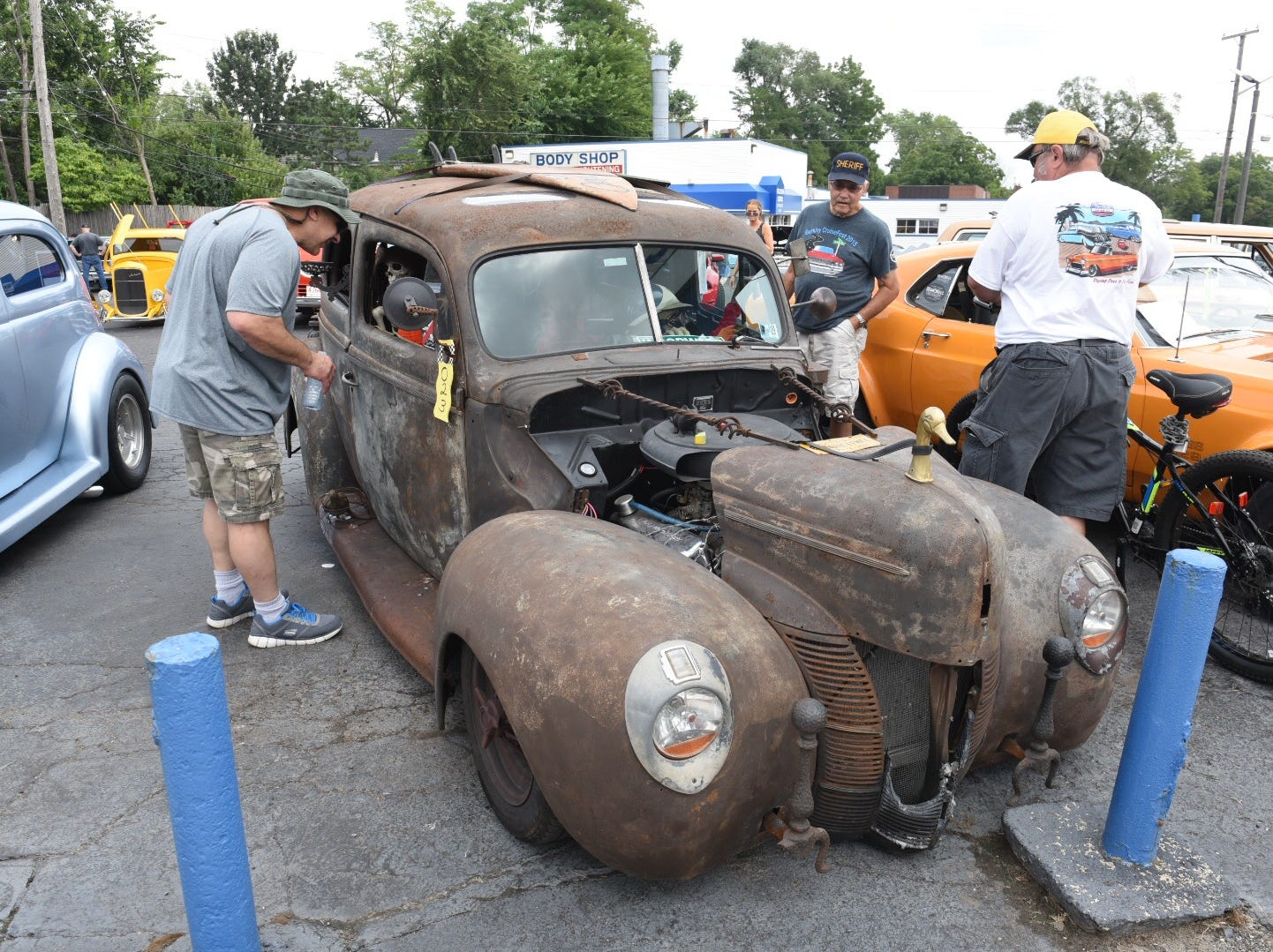 A man peers at a skeleton inside a 1940 Ford sedan in rusted and crispy condition. Owner Chuck Phillips of Smithville, Pennsylvania, displayed it along Woodward at Webster in Royal Oak. Max Ortiz, The Detroit News
