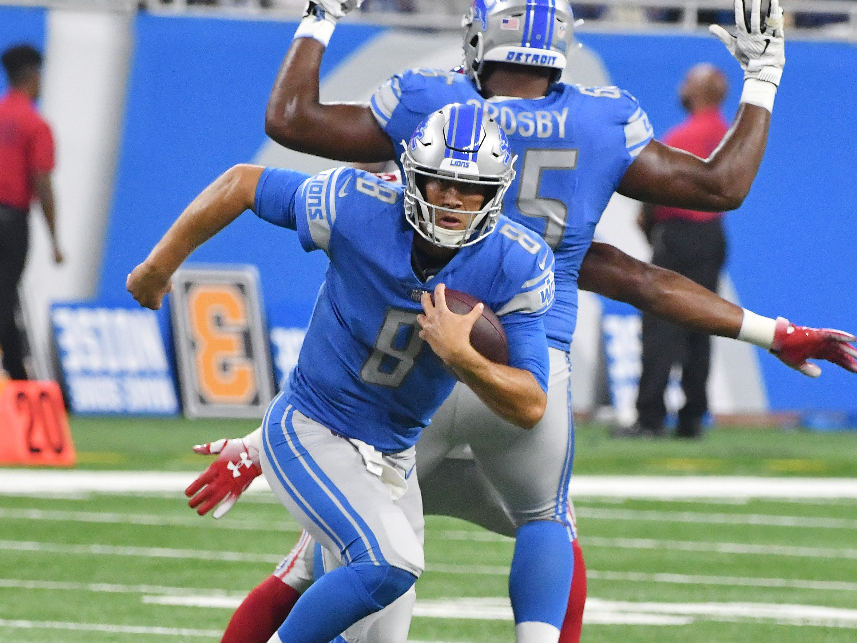 Lions quarterback scrambles out of the pocket for a gain in the third quarter.