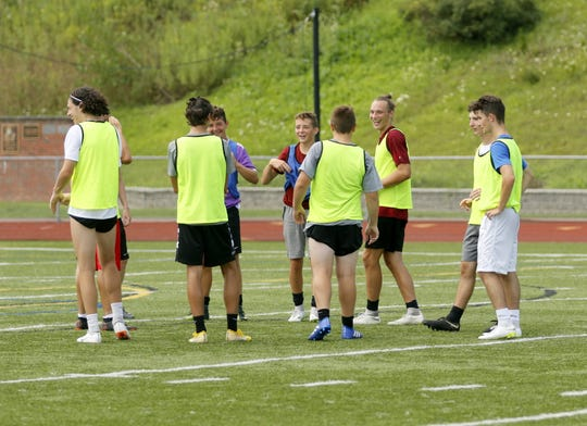 The Elmira High School boys soccer team practices Aug. 17 at Marty Harrigan Athletic Field at Ernie Davis Academy.