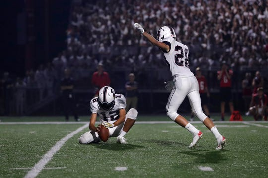 Fond du Lac's Jared Scheberl kicks the game-winning field goal against Kimberly on Friday night, ending the Papermakers' 70-game winning streak.