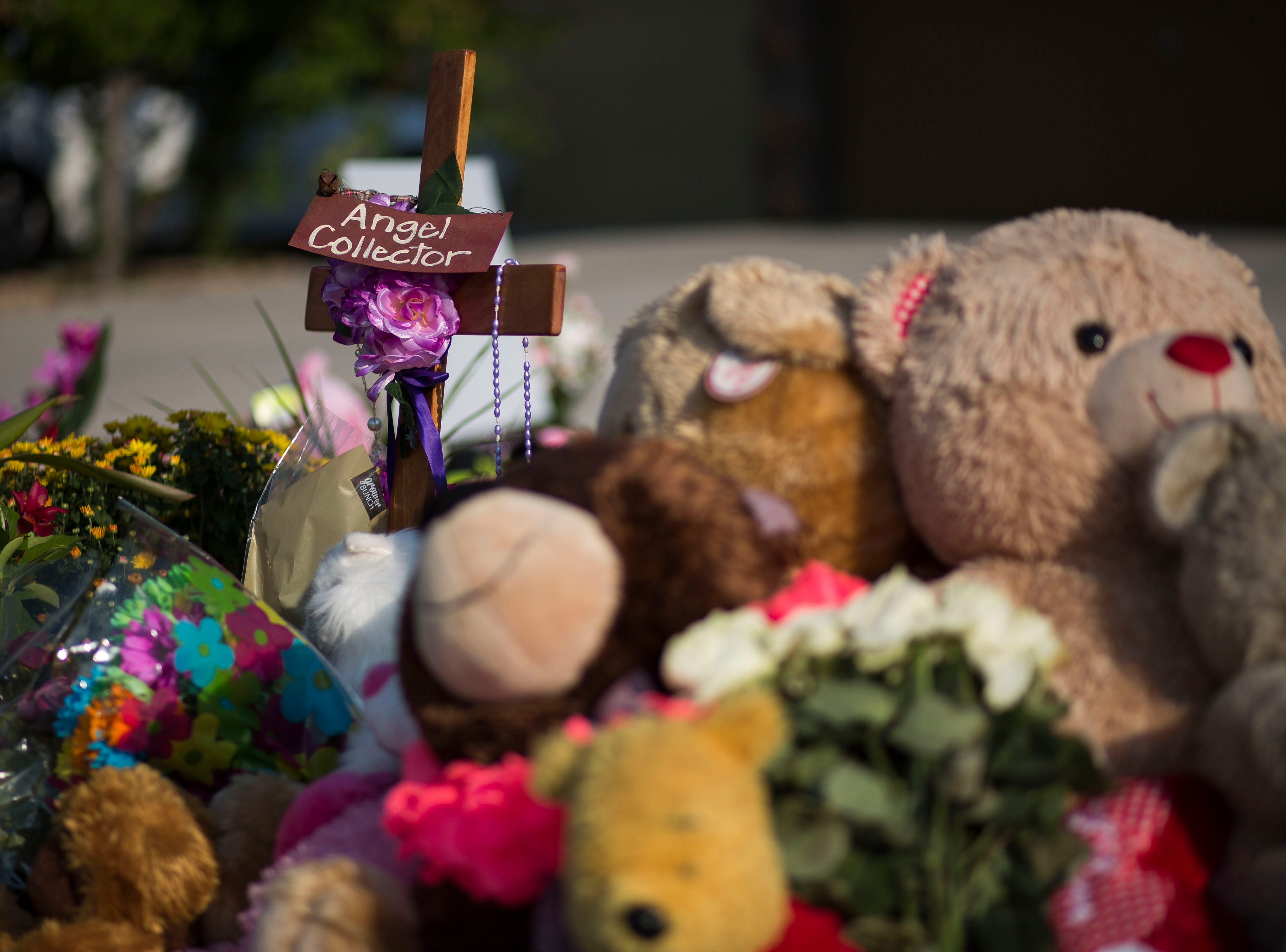 A memorial of flowers, stuffed animals and hand-written notes sits in the front yard in memory of slain Shanann Watts and her two daughters, Bella, 4, and Celeste, 3, in front of the Watts' family home on Friday, Aug. 17, 2018, in Frederick, Colo.