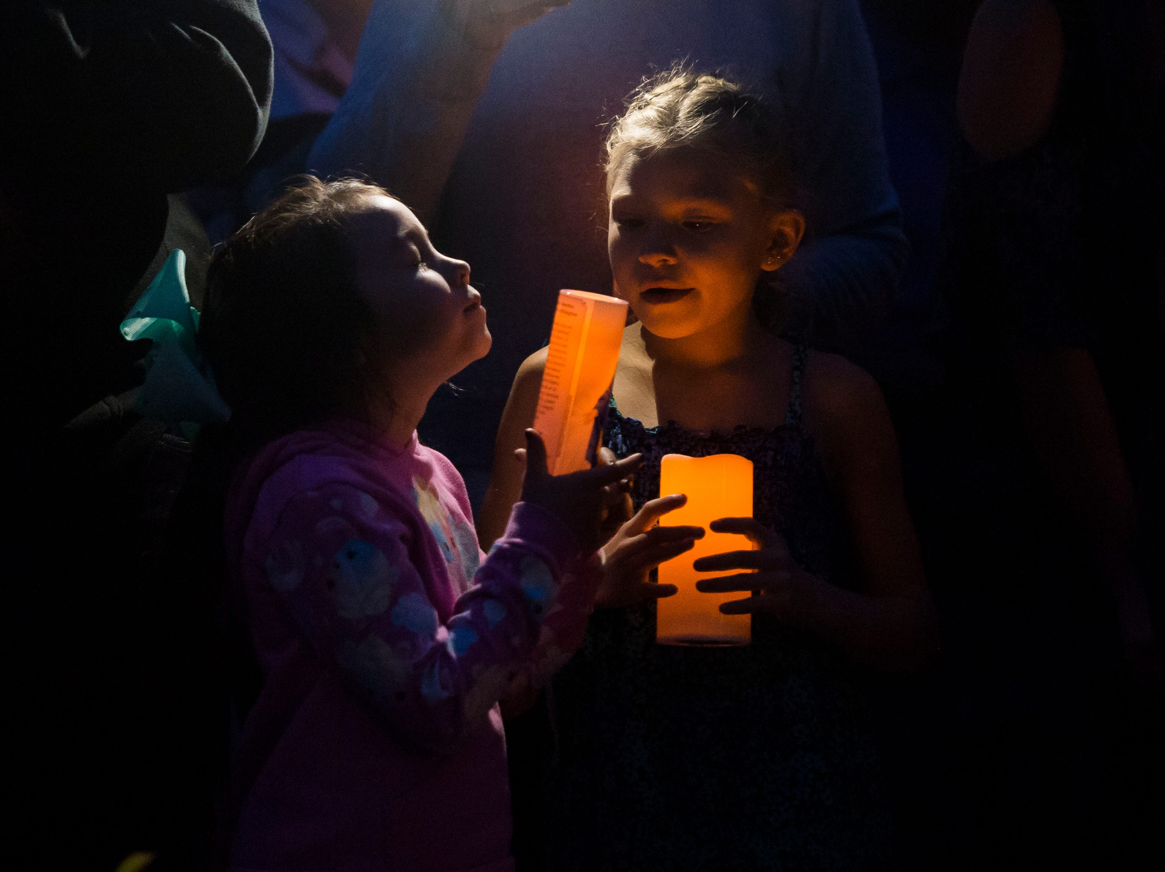Children participate in a candle-lit vigil for the slain Shanann Watts and her two daughters, Bella, 4, and Celeste, 3, in front of the Watts' family home on Friday, Aug. 17, 2018, in Frederick, Colo.