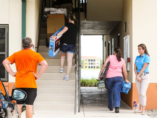 Students move into the North Lake Village on FGCU campus. President Mike Martin handed out water to students and parents as they are moving into to the residence halls on Friday. This is a ritual that reminds him why he does this job.