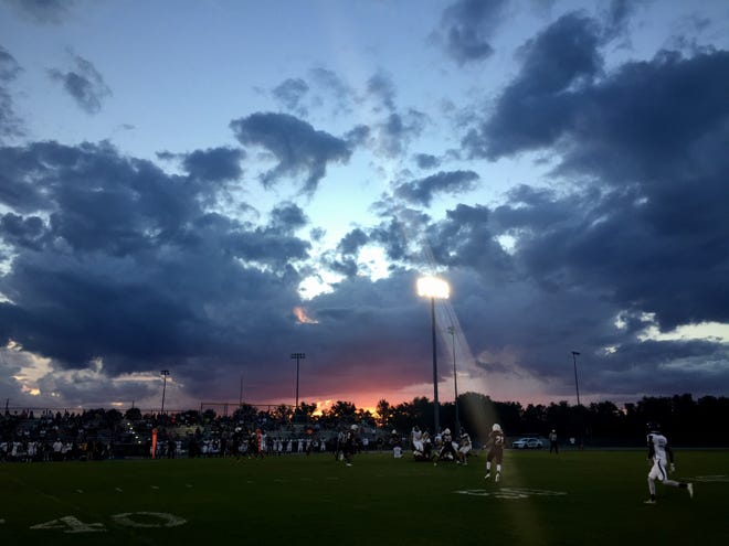 Sundown at Riverdale High School as the Raiders face Cypress Lake in a preseason high school football game on Friday, Aug. 17, 2018.